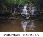 rain forest and waterfall... | Shutterstock . vector #1168458472