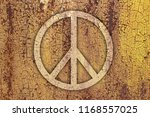 sign of peace on a rusty metal... | Shutterstock . vector #1168557025