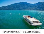 motor boat on lake garda in... | Shutterstock . vector #1168560088