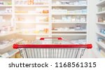 empty red shopping cart with... | Shutterstock . vector #1168561315