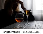 woman drinking alcohol alone... | Shutterstock . vector #1168568608
