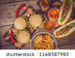 hotdogs and burgers on a wooden ... | Shutterstock . vector #1168587985