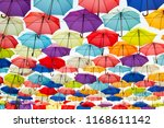 street decorated with colored... | Shutterstock . vector #1168611142