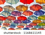 street decorated with colored... | Shutterstock . vector #1168611145