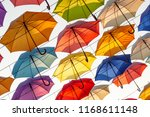 street decorated with colored... | Shutterstock . vector #1168611148