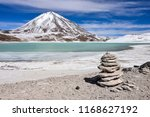 a rock pile stands in front of... | Shutterstock . vector #1168627192
