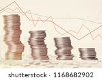graph and rows of coins.... | Shutterstock . vector #1168682902