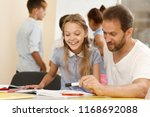 professional male tutor... | Shutterstock . vector #1168692088