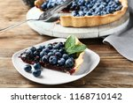 plate with piece of delicious... | Shutterstock . vector #1168710142