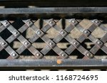 forged grating. forged fence.... | Shutterstock . vector #1168724695