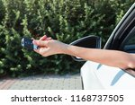 woman's hand presses button on... | Shutterstock . vector #1168737505
