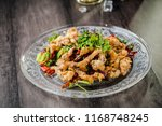 spicy squid with seafood dish | Shutterstock . vector #1168748245