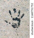 black handprint. the imprint of ... | Shutterstock . vector #1168751752