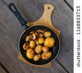 golden fried potatoes on pork...
