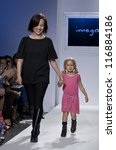 NEW YORK - OCTOBER 20: Heajung Chung & girl walk runway for petite Parade collection by Imoga during kids fashion week NYC sponsored by Vogue Bambini at Industria Superstudio on October 20 2012 in NYC - stock photo