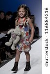 NEW YORK - OCTOBER 20: Girl model walks runway for petite Parade show collection by Imoga during kids fashion week NYC sponsored by Vogue Bambini at Industria Superstudio on October 20, 2012 in NYC - stock photo