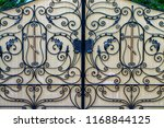 wrought iron gates  ornamental... | Shutterstock . vector #1168844125