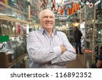 Mature manager  in  auto parts store - stock photo