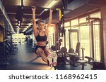 young sportswoman lifting up on ... | Shutterstock . vector #1168962415