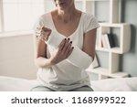close up of female broken arm... | Shutterstock . vector #1168999522