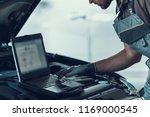 close up auto mechanic working... | Shutterstock . vector #1169000545