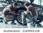 Mechanics checking wheel...