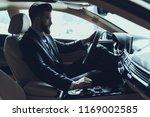 business man driving car...   Shutterstock . vector #1169002585