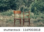 pair old wooden chair outdoors. ... | Shutterstock . vector #1169003818