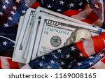 American Flag And Banknotes Us...