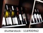 Wine Bottles On A Wooden Shelf. ...