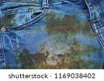 dirty stain on jean texture... | Shutterstock . vector #1169038402