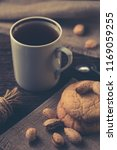 a cup of black tea with cookies. | Shutterstock . vector #1169059255