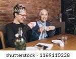 senior mother sitting in cafe... | Shutterstock . vector #1169110228
