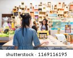 woman picking product inside...   Shutterstock . vector #1169116195