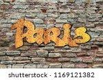 paris logo on brick wall... | Shutterstock . vector #1169121382