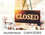 old close sign hanging front of ... | Shutterstock . vector #1169132305
