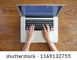 hands of young female person... | Shutterstock . vector #1169132755