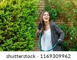 smiling young woman with garden ... | Shutterstock . vector #1169309962