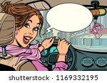 joyful woman behind the wheel... | Shutterstock .eps vector #1169332195
