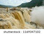 hukou waterfall  the yellow... | Shutterstock . vector #1169347102