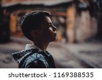pre teen boy on a street in a... | Shutterstock . vector #1169388535