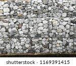 gabion rock retaining wall ... | Shutterstock . vector #1169391415