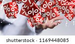 shopping symbol in hand | Shutterstock . vector #1169448085