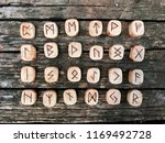 A Stack Of Wooden Runes At...