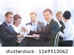 business team discussing the... | Shutterstock . vector #1169513062