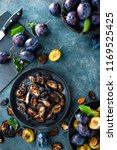 dried prune and fresh plums... | Shutterstock . vector #1169525425