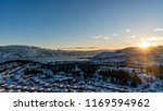 View of West Kelowna and the Okanagan Lake at Sunset in winter