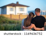 couple looking at they's house | Shutterstock . vector #1169636752
