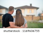 couple looking at they's house | Shutterstock . vector #1169636755