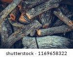 pile of firewood.firewood... | Shutterstock . vector #1169658322